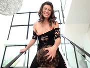 Hot Latina Julia Roca shows off her fabulous body in a string body stocking and stilettos. ...