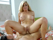 Shaved cougar with big-sized tits Parker Swayze sucks dong and rides it vehemently