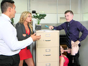 Busty secretary Ryan Smiles seducing her well-endowed boss in the office room