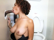 Slender ebony girl Raven plays with the glory hole in the toilette room