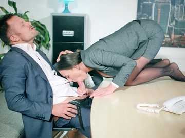 Brunette business woman Mea Melone is interested in the manager's big dick
