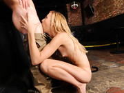 Alexa Grace sits on the counter and spreads her legs to show shaved cave